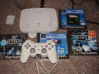 PLAYSTATION ONE SLIM WITH GAMES