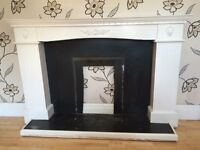 LOVELY ORNATE WHITE FIRE SURROUND WITH ORNATE DESIGN AND HEARTH