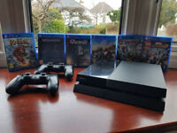 Playstation 4 console with 2tb hhd, 2 controllers and games