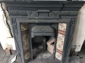 Attractive Black Iron Fireplace Surround with pretty inset tile detail design