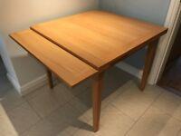 Extendable oak veneer John Lewis dining table.