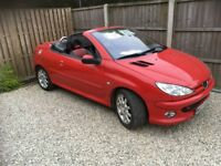 Beautiful red Peugeot 206cc convertible leather interior windbreaker etc.