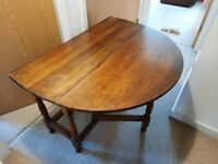 Varnished Hard Wood oval Kitchen Table, No chairs included.