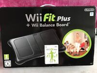 Wii black console and Wii Fit plus board