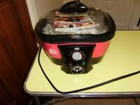 8-in-1 Cooker by JML, Go Chef, complete with instructions and attachments, sold as seen.