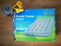 Inflatable double mattress with portable pump
