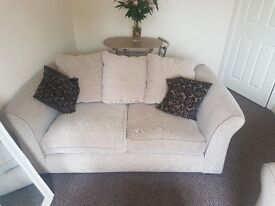 Two sofas and a foot stool with storage