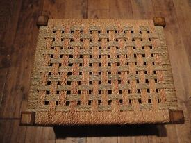 Small wooden stool with woven top