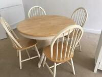 Round extending dining table a 4 chairs