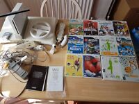 Nintendo Wii and Wii fit board plus 12 games