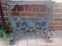Victorian style cast iron verdigris table, chair and bench ends with lions head detail