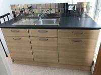 Kitchen cupboards with sink and integral fridge