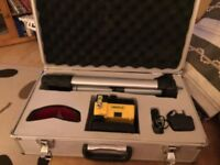 Rotary laser level on stand