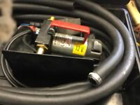 Diesel fluid transfer pump and hoses