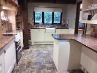 Cream Shaker-style Crown Imperial kitchen with granite worktops