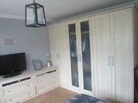 Beautiful light Beech fitted wardrobes and matching drawers
