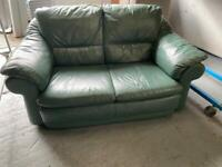 Two Piece Leather sofas set in good condition real comfy