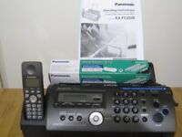 Panasonic telephone/answering machine/copier/fax with spare fax roll