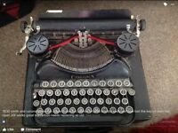 Smith and corona type writer with original box thought the lock is broken still in working order