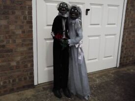 Gothic life size singing figure of Zombie married couple.