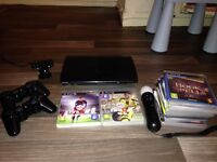Playstation 3 Super Slim + PS3 Camera and 3 Controllers