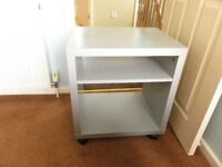 Silver grey bedside unit/TV table on easy glide castors
