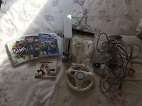 White Nintendo wii console hand set and asseccories with 4 games