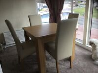 Brand new dinning table and four chairs