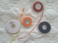 Various reels of ribbon partly used. Some about 6/7mm and one 8mm