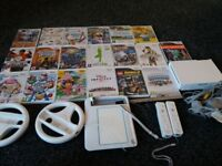 nintendo wii with large bundle of games