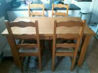 Solid pine very sturdy dining table 4 chairs