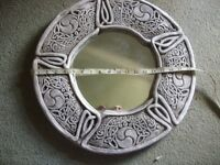 Round mirror with Celtic design , looks like stone