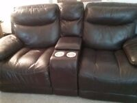 Large 2 seater reclining sofa. Dark brown leather double padding. Couple of small marks