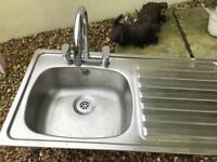 Kitchen sink and taps