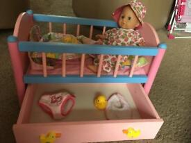 Baby born crib and a doll