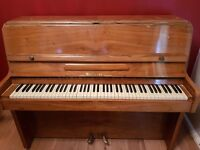 Molineux upright piano with stool.