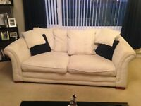 Cream DFS 3 seater sofa and two armchairs.