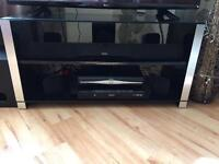 Black/silver glass tv stand with shelves.