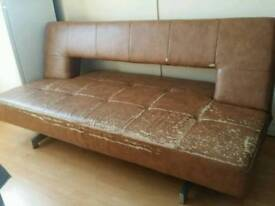 Brown leather sofa bed