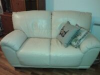 Cream leather two seater sofa