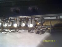 A SOPRANO SAXOPHONE In GOLD LACQUER .with MOUTHPIECE & CASE . A WELL MADE INSTRUMENT +