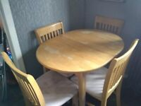 Extendable pine table and four chairs in need of some TLC
