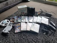Wii with 3 steering wheels , 2 controls and lots of games . Great condition