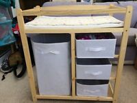Changing table with storage compartments and changing mat by Infantastic