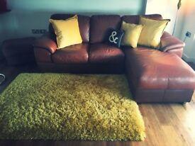 Corner sofa with footstool
