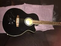 Acoustic guitar signed by Paolo Nutini