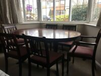 Dark Wood Extending Dining Table with 6 chairs. £240 ONO