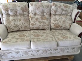 Three piece suite beige floral material 2 recliners