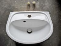 small white ceramic sink with push plug hole and wall screws clean unmarked fromrevamped toilet