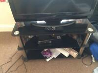 Black glass tv stand excellent condition 80cm length